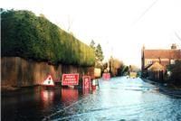 Jude Cobbings, BGS © NERC 2003 - a road flooded by groundwater