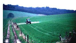 John Chilton, BGS © NERC 1998 - a tractor applying pesticide
